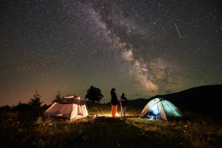 Looking at Stars at Night While Camping