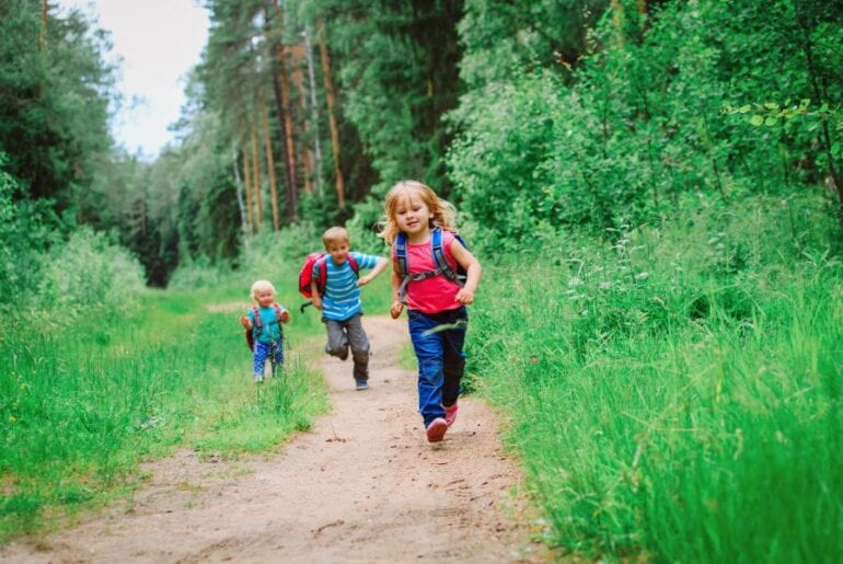 Toddlers Running Down Trail