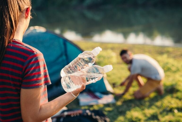 Holding Bottled Water While Camping