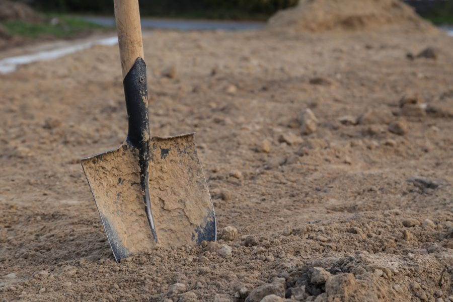 Dirty Shovel in Dry Clay Soil