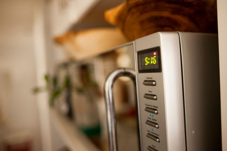 Angled Shot of Microwave With Clock