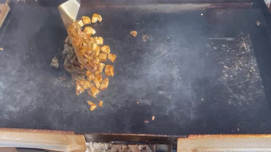 Own - Zesty Honey BBQ Chicken Wrap on the Blackstone Griddle - Mix Onion and Chicken Together