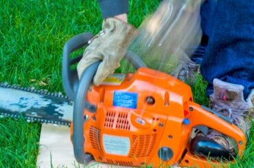 Pulling Cord to Start Chainsaw