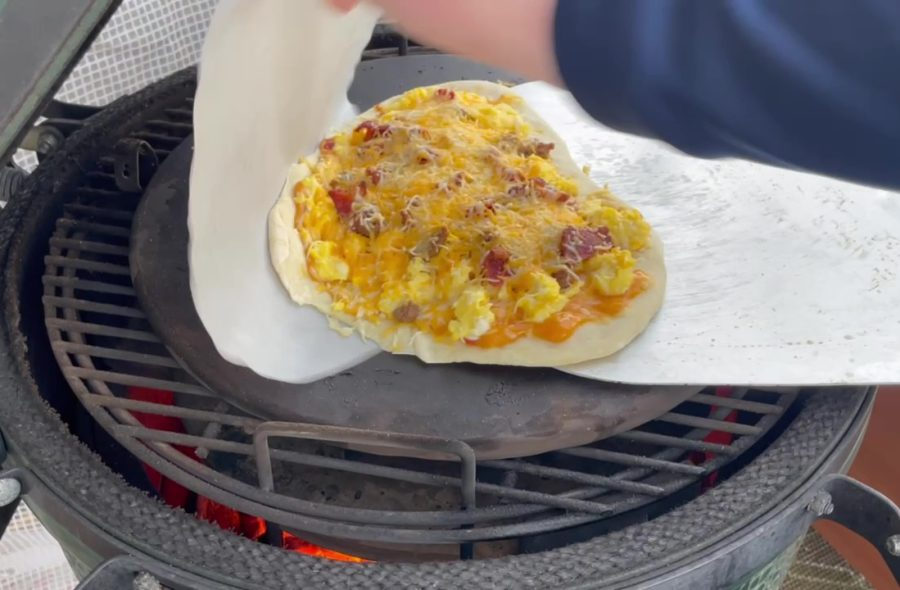 Own - Delicious Breakfast Pizza on the Big Green Egg (Kamado Joe) - Remove Parchment Paper and Rotate Pizza