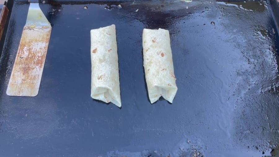 Own - Breakfast Burrito on the Blackstone Griddle - Place the burrito seams side down on the Blackstone