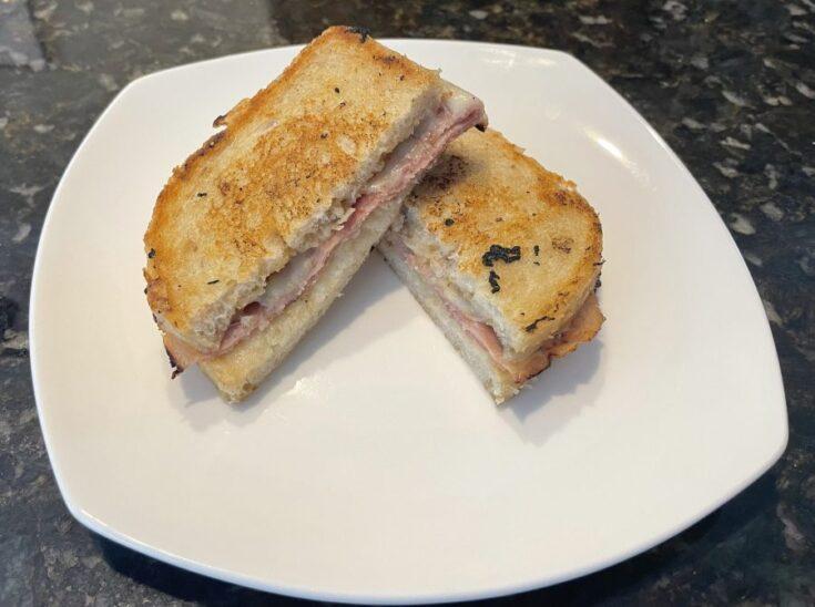 Own - Dijon Ham & Swiss w Parmesan Sauce Panini on the Blackstone - Plated